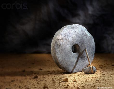 A Stone Wheel And Caveman's Stone Hammer Illustrating ...