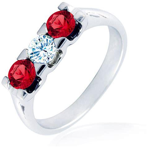 Anillo Trilogy   Oro blanco 18K con diamante y rubíes   1199