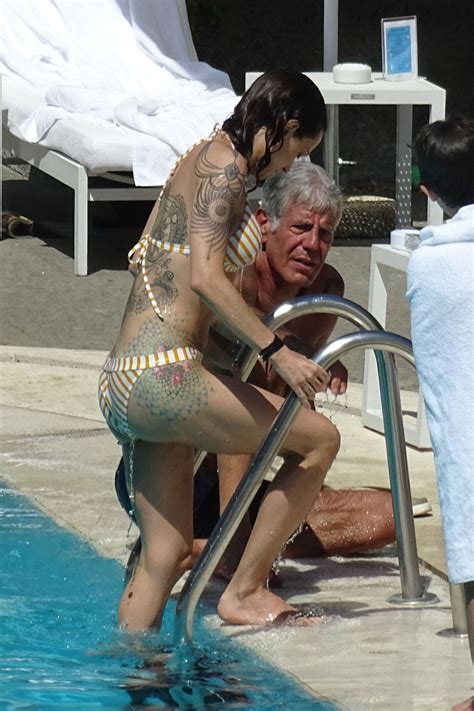 ASIA ARGENTO in Bikini and Anthony Bourdain at a Pool in ...