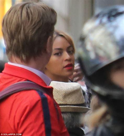 Beyoncé gets snap happy in Barcelona as Jay Z cradles Blue ...