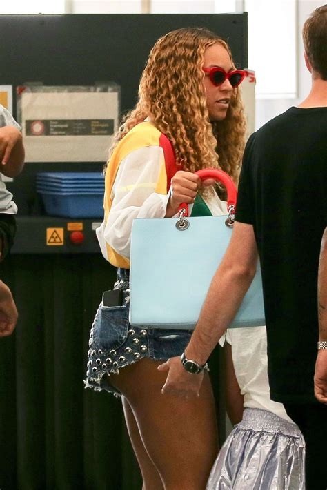 Beyonce in Jeans Shorts with Jay Z   Arrived in Barcelona