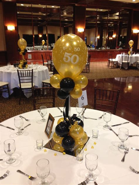 Black and gold balloon centerpieces for a 50th birthday or ...