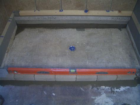 Building a concrete shower pan on a basement floor. Brick ...