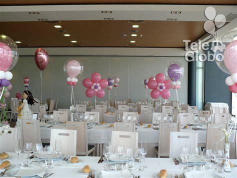 Centros de mesa en una decoración para Primera Comunión ...