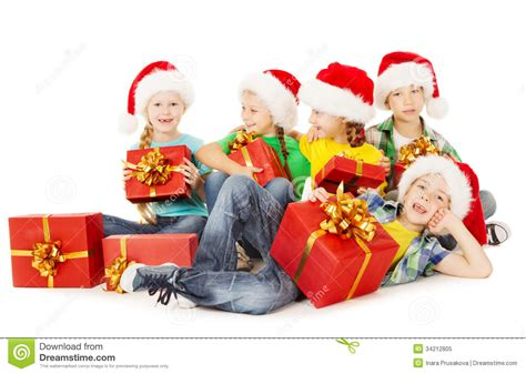 Christmas Helpers Kids In Santa Hat Holding Presen Stock ...