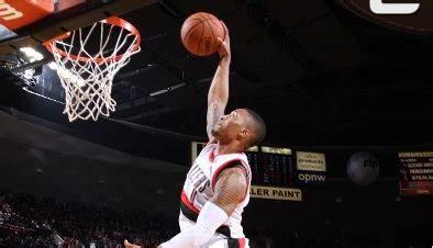 Damian Lillard throws down a dunk in OT off a behind the ...