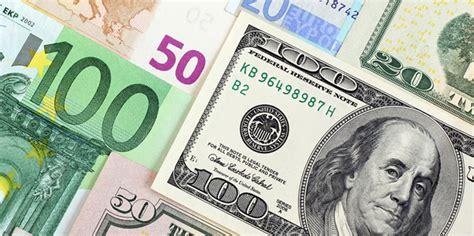 Dollar edges higher versus euro