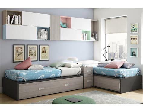 Dormitorio juvenil con dos cama nido dispuestas en L ...