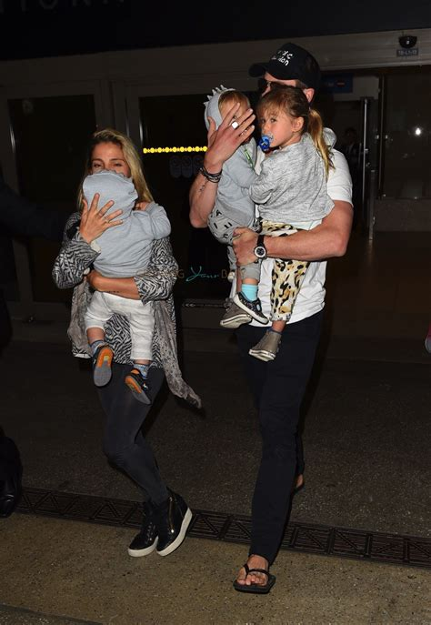 Elsa Pataky and Chris Hemsworth at LAX with their kids ...