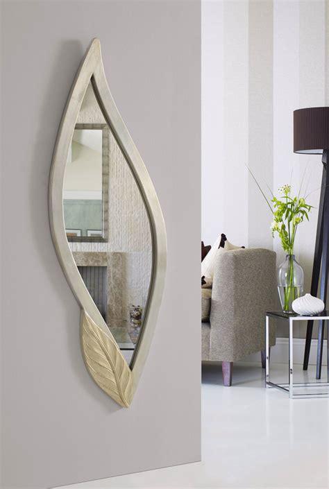 Espejos decorativos en pan de plata