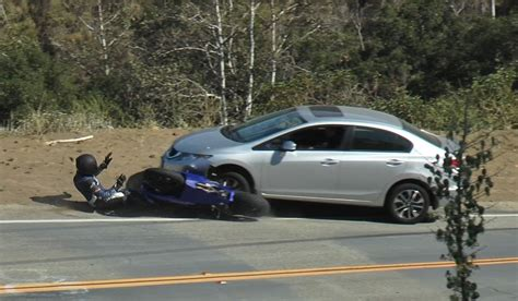 EXTREME FOOTAGE: Motorcycle Head On Collision With Car