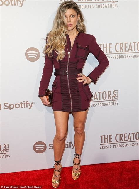 Fergie dons burgundy dress at Spotify Creators party in ...