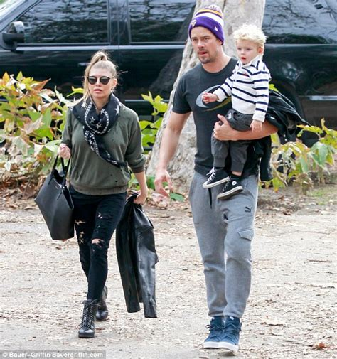 Fergie wears leather and denim as she and Josh Duhamel ...