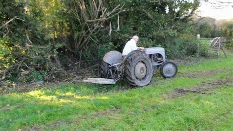 Ferguson T20 Pulling Out Tree Trunk - YouTube