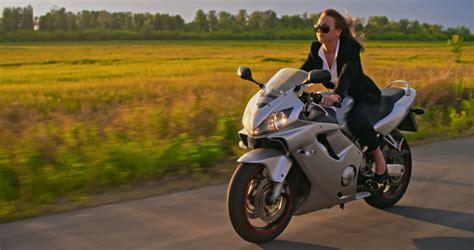 Follow Shot Of Businesswoman Riding Her Motorbike Stock ...