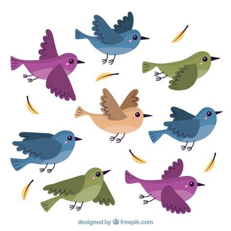 Fondo plano de pájaros volando   Descargar Vectores gratis