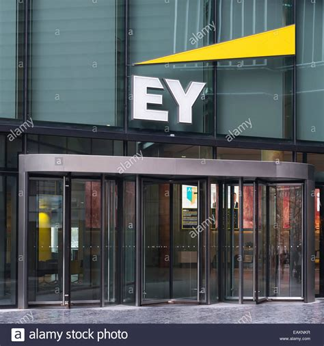 Front door of the offices of EY, Ernst and Young, at More ...