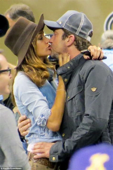 Gerard Butler and girlfriend Morgan Brown kiss at Saints ...