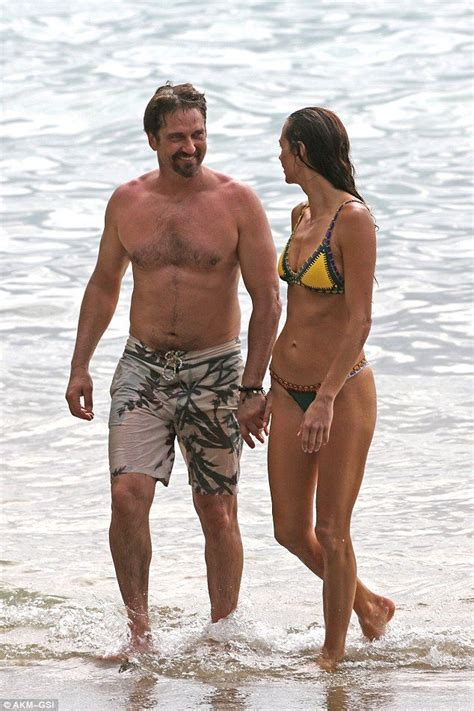 Gerard Butler and his bikini clad girlfriend Morgan Brown ...