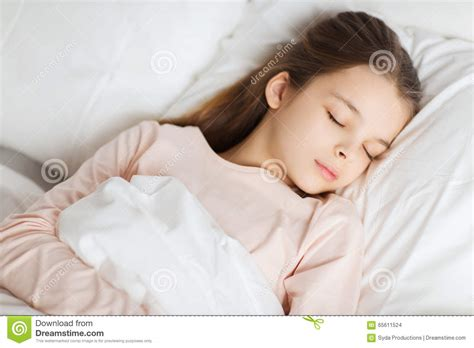 Girl Sleeping In Bed At Home Stock Photo - Image: 65611524