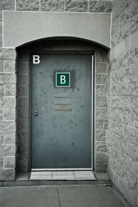 Gray metal Exterior Door Marked with the Letter B | Door ...