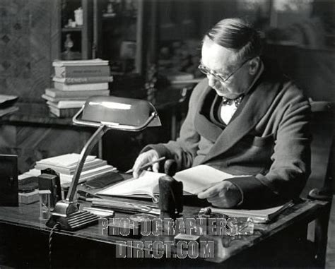 H G Wells at writing desk British author and sociologist ...