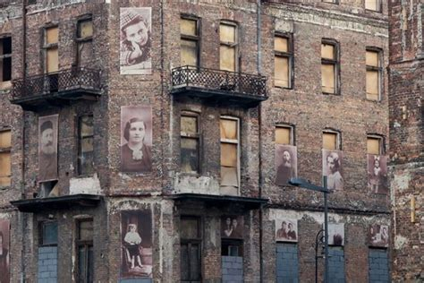 Holocaust remembrance advocates plastered images of Polish ...