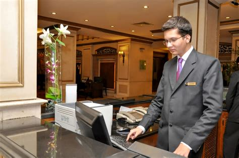 Hotel Management trainee working at the front desk at the ...