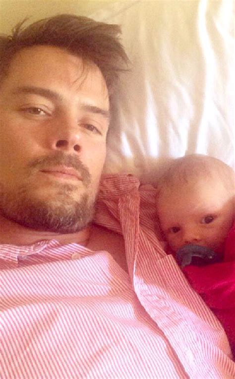 Josh Duhamel watches some football with baby Axl Jack ...