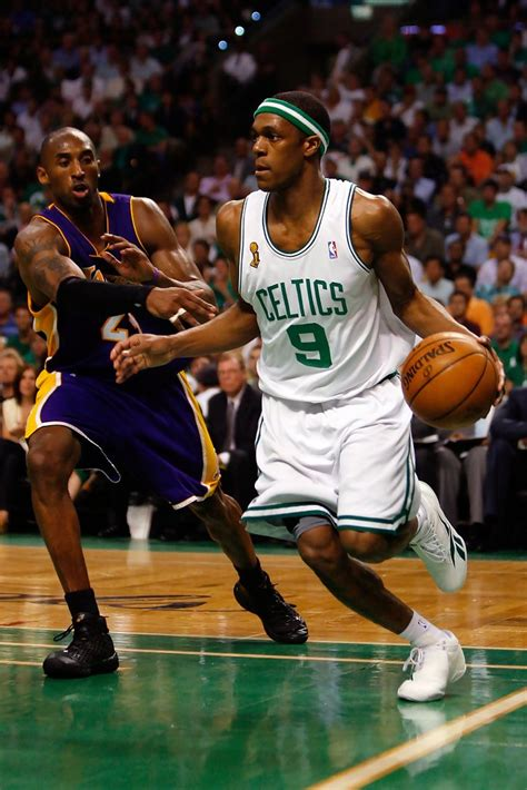 Kobe Bryant and Rajon Rondo Photos Photos - NBA Finals ...
