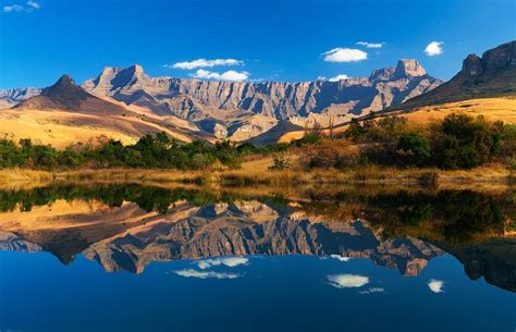 landscape photo of the Amphitheater reflected in a fishing ...