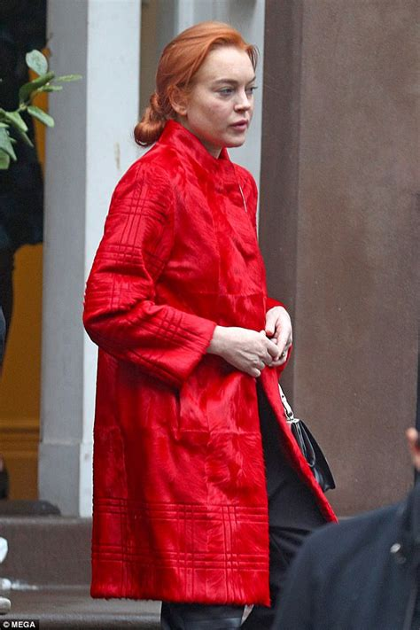 Lindsay Lohan steps out wearing a loud red jacket in NYC ...