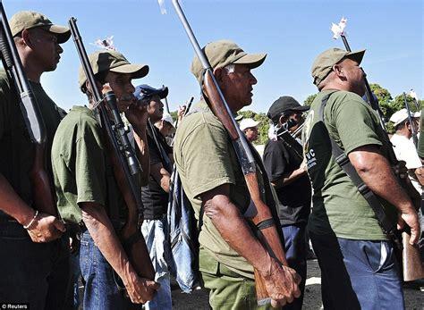 Mexican vigilante gunmen disarm local POLICE so they can ...