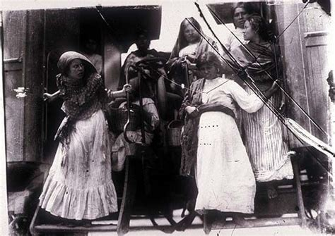 Mexican women disembarking from a train during the Mexican ...