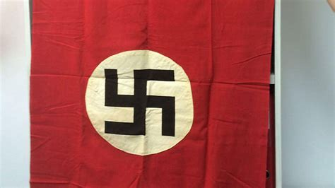 Nazi flag from Buchenwald bequeathed to Israel, delivered ...