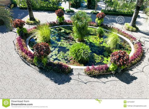 Ornamental Garden Pond With Water Plants And Flowers Stock ...