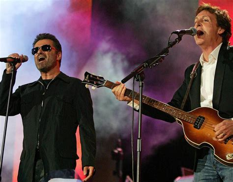 Paul McCartney and George Michael perform at the Live 8 ...