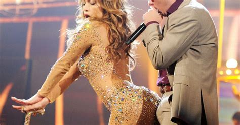 Pitbull looks very  excited  by his performance with ...
