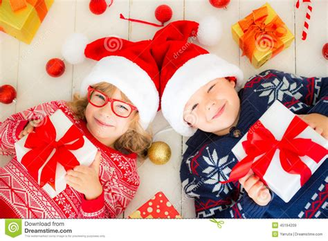 Portrait Of Happy Children With Christmas Decorations ...