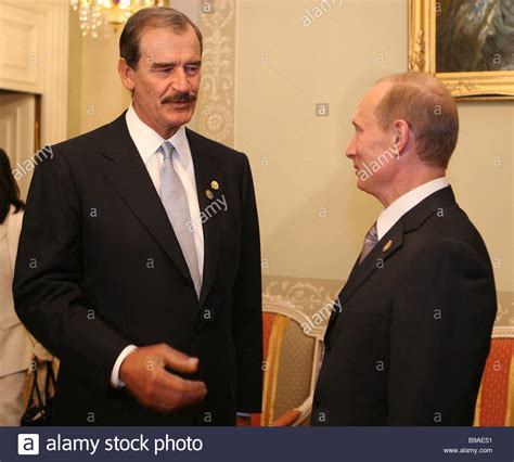 President Vladimir Putin of Russia and President Vicente ...