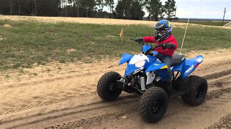 Riding Polaris Outlaw 90 four wheelers - YouTube