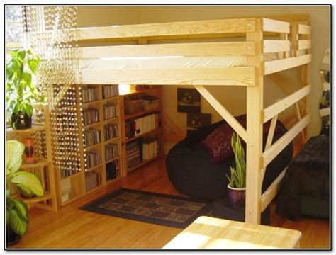rustic adult loft bed with stairs with bookshelf at the ...
