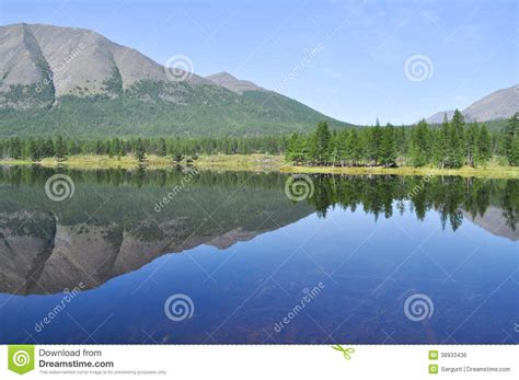 Scenery Of The Lake And Reflections Of Mountains Stock ...