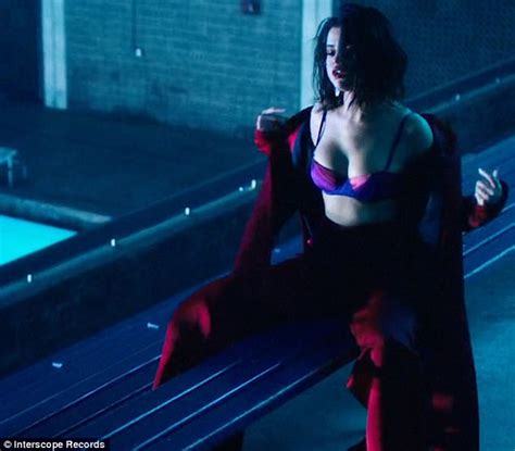 Selena Gomez stuns in silk bra and wet hair for Wolves vid ...