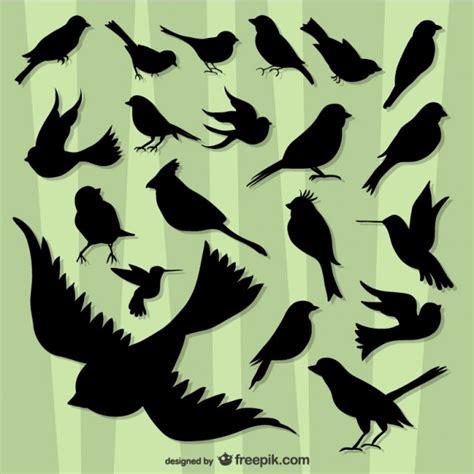 Siluetas de pájaros volando   Descargar Vectores gratis