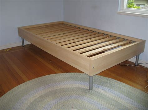 Simple Wooden Ikea Twin Size Bed Frame With Metal Legs On ...
