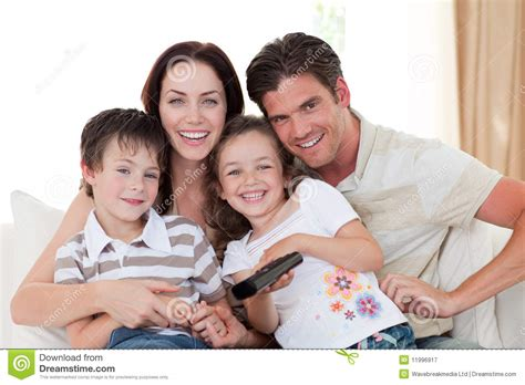 Smiling Family Watching TV In The Living Room Royalty Free ...