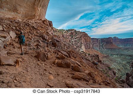 Stock Photo of Hiking Canyonlands Backpacker on the trail ...