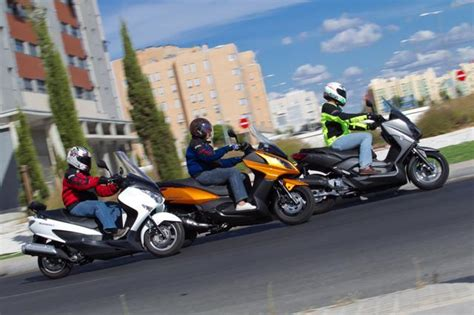 Suzuki Burgman 125 cc, Kymco Superdink 125 cc y Yamaha ...