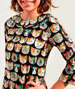 Tela de algodon patchwork con estampado de caritas de gatos.